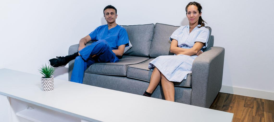Two residents sat on the sofa in their student accommodation shared lounge.